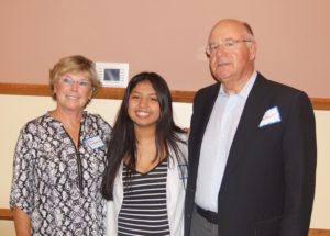 Stillwater Area High School student Diana Martinez with Gary and Mary Malmquist.